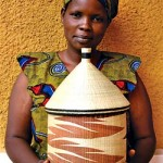 Rwanda: Gahaya Links member Christine Uwera with one of her peace baskets. Photograph courtesy of Willa Shalit, Fair Winds Trading.