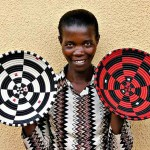 Rwanda: Gahaya Links cooperative member Aristude Mukashyaka, displaying her baskets, 2009. Photograph courtesy of Fair Winds Trading.